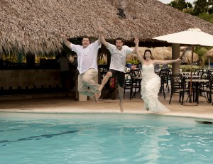 Wedding photographer jumps into pool with couple during trash the dress session