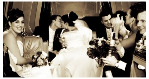 Bride and Groom kiss in the limo